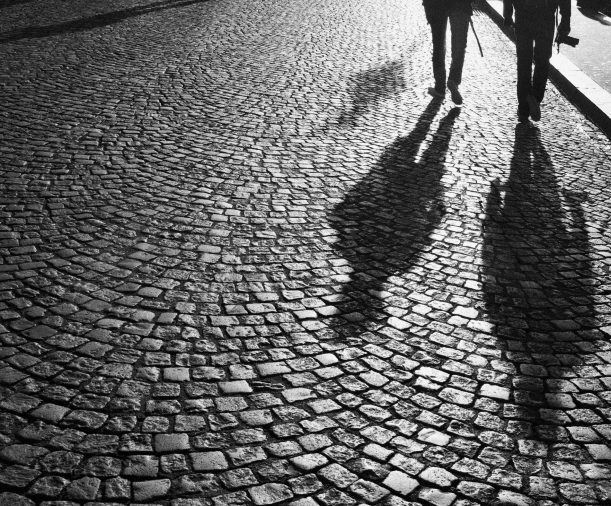 Photographers at morning photo shoot on cobbled paving in front of Sacre Coeur at Montmartre, Paris.